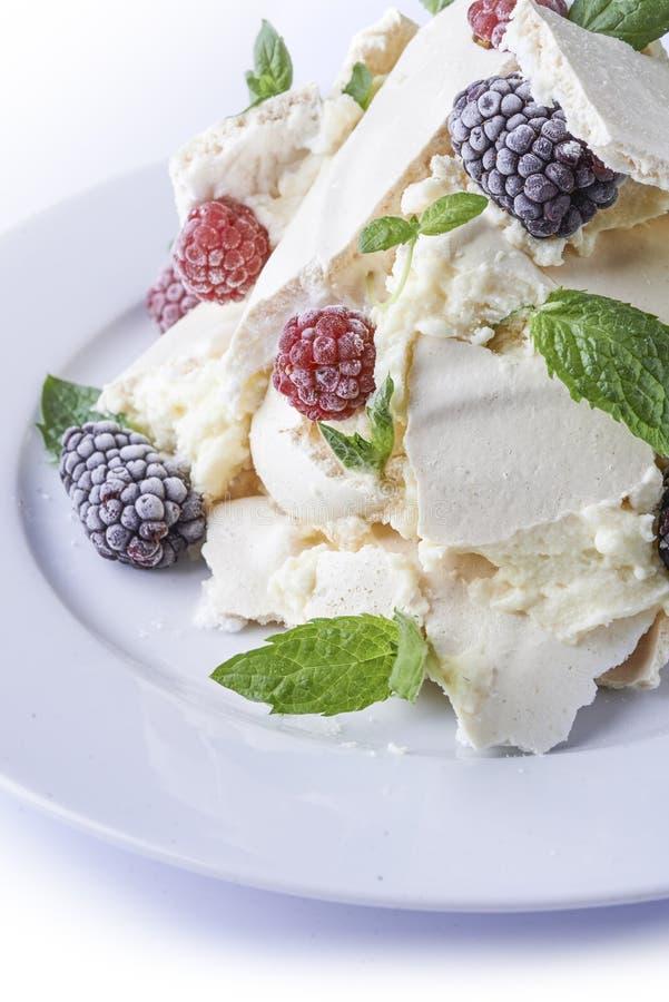 Meringue cake with berries stock image