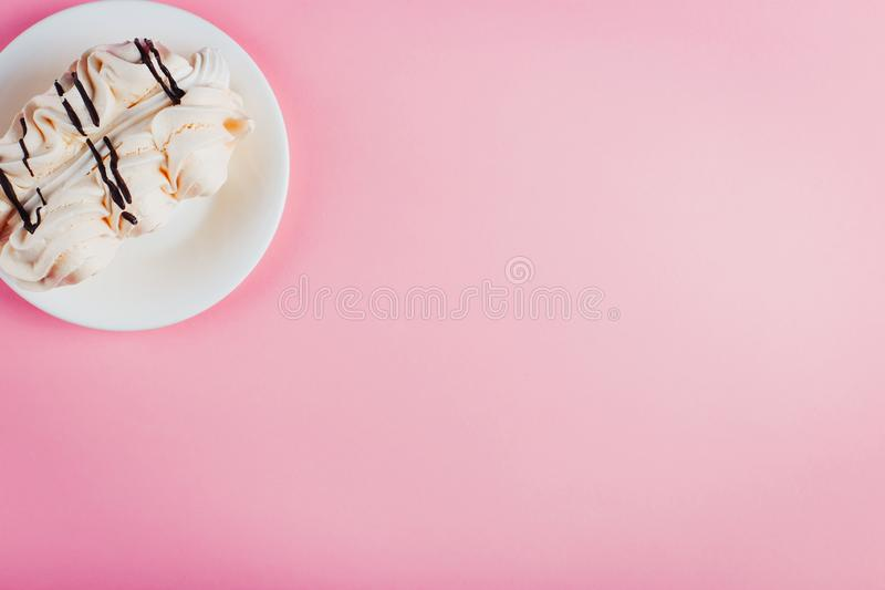 Meringue cake on a saucer, on a soft pastel background stock photography