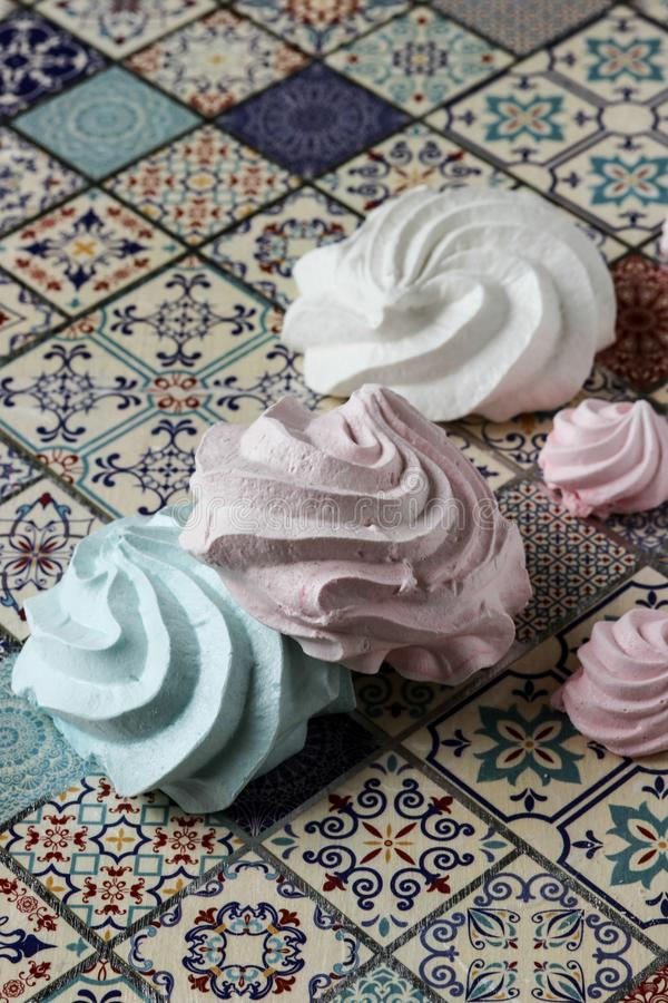 Meringue cookies. Pink, green and white royalty free stock images