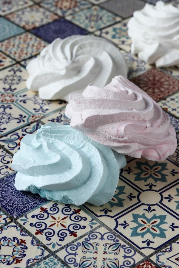 Meringue cookies. Pink, green and white stock images