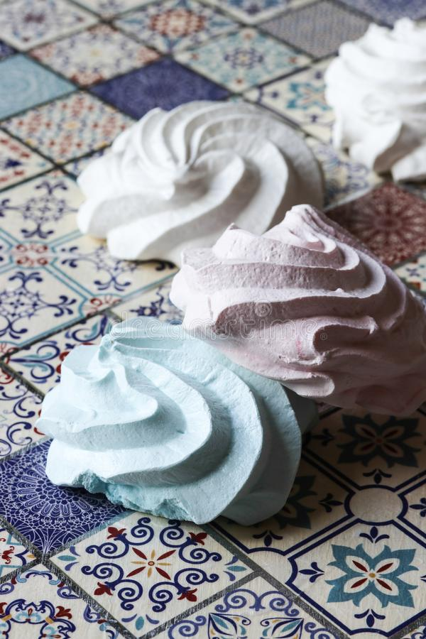 Meringue cookies. Pink, green and white stock image