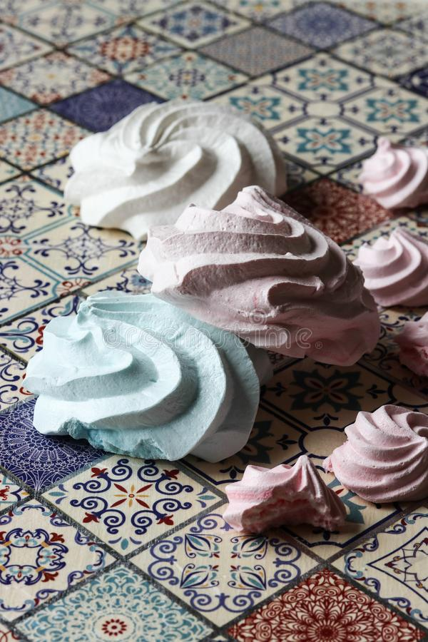 Meringue cookies. Pink, green and white royalty free stock photos