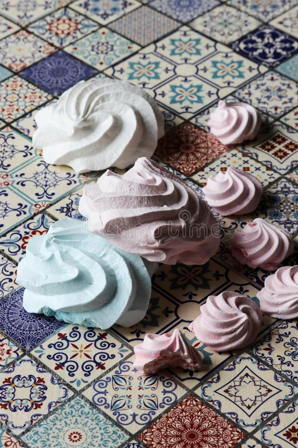 Meringue cookies. Pink, green and white royalty free stock photo