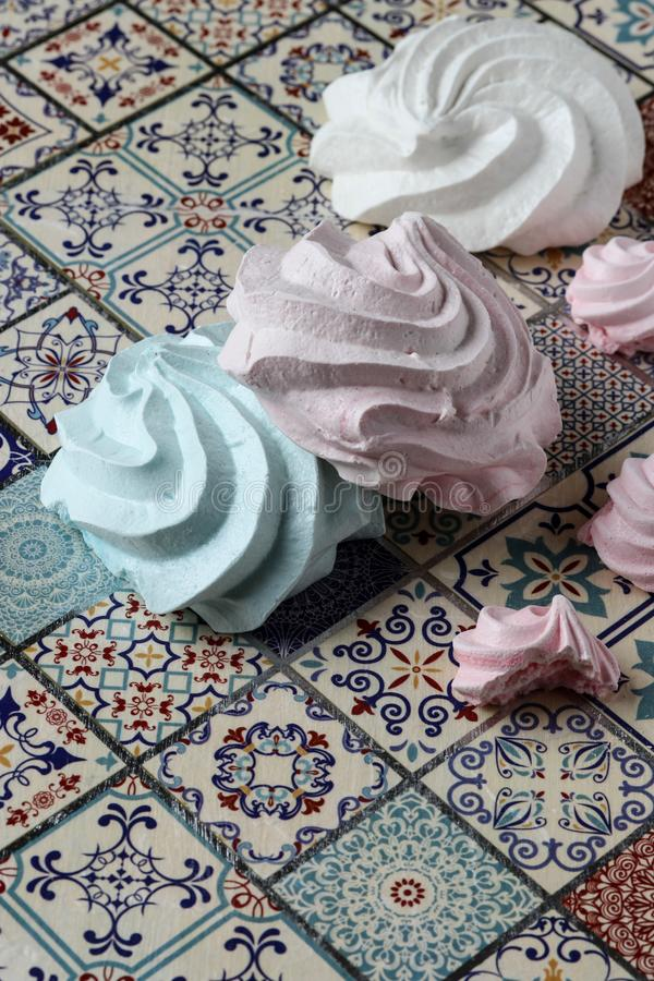 Meringue cookies. Pink, green and white stock photo