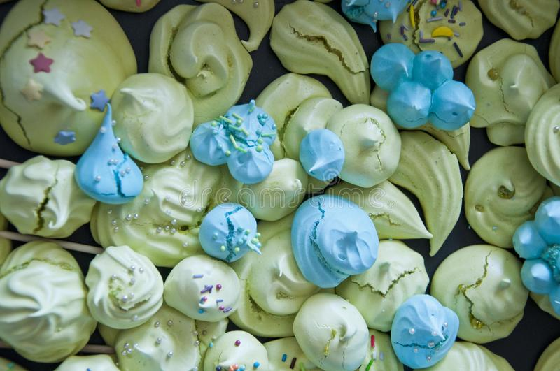 Meringue top view background. sea shell dessert. trendy french cookies flat lay. green and blue color candy. whipped egg white swe. Ets royalty free stock photos