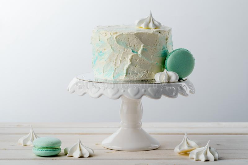 Meringues, cake and macaroni sweets stock images