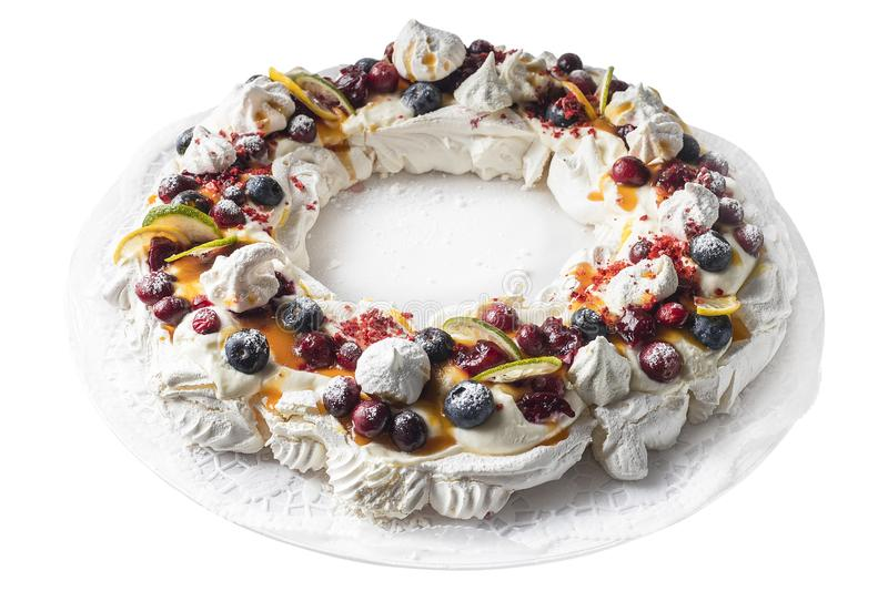 Meringues pavlova cake wreath with cherry, blueberry, lemon, cranberry and lime. stock images
