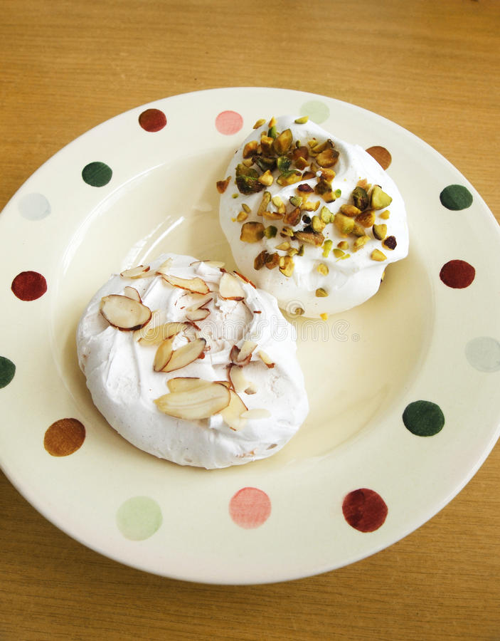 Download Meringues on plate stock image. Image of flaked, delicacies - 24524325