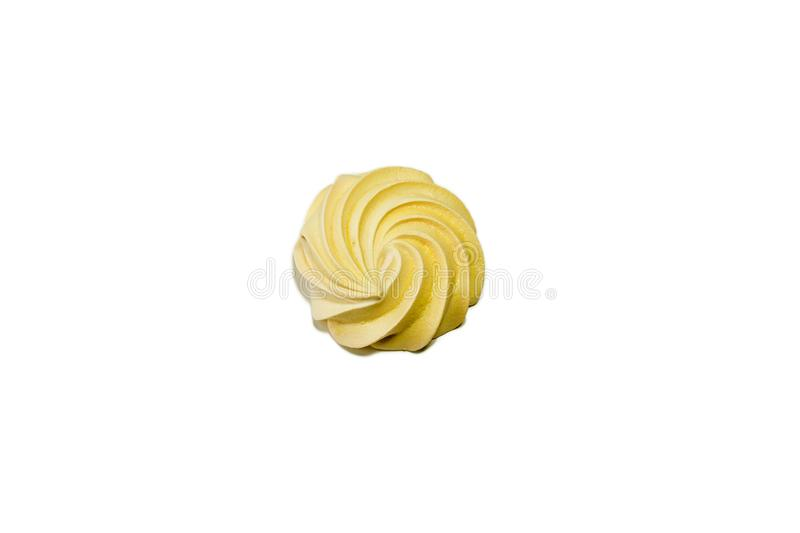 Meringues on a white background. Sweet airy-tender meringue of yellow green and pink on a white background stock photo