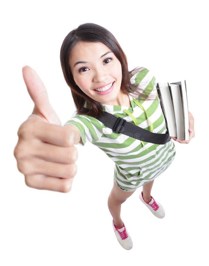 Merito - i pollici della studentessa aumentano il gesto di mano fotografia stock libera da diritti