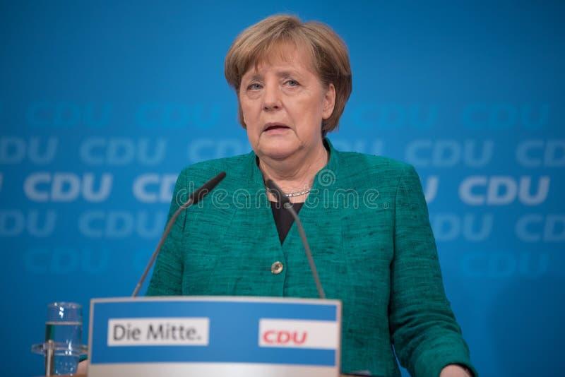 Merkel bij een persconferentie vóór het grote besluit over de grote coalitie royalty-vrije stock fotografie