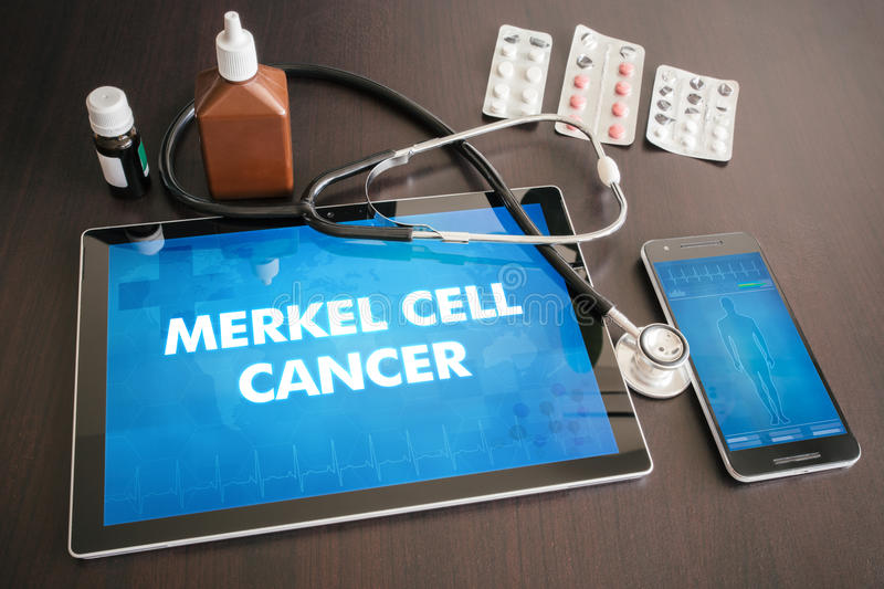 Merkel cell cancer (cancer type) diagnosis medical concept on ta. Blet screen with stethoscope royalty free stock photo