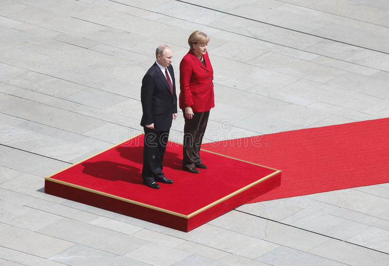 Merkel Putin. German Chancellor Angela Merkel welcoms Russian President Vladimir Putin with military honours at the chancellery in Berlin, Germany royalty free stock photo