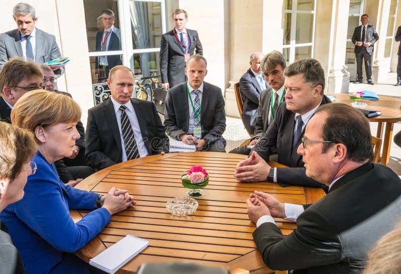 Merkel, Putin, Poroshenko and Hollande. PARIS, FRANCE - Oct 02, 2015: German Chancellor Merkel, Russian President Vladimir Putin, President Ukraine Petro royalty free stock photos