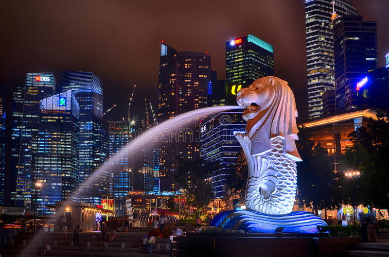 Merlion in the night stock image