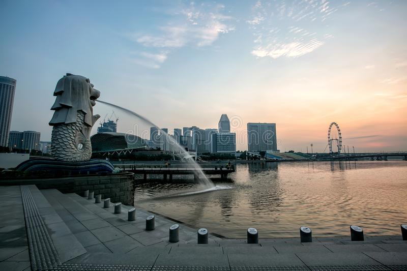 Beautiful Merlion Park is a Icon of Singapore When Sunrise. royalty free stock images
