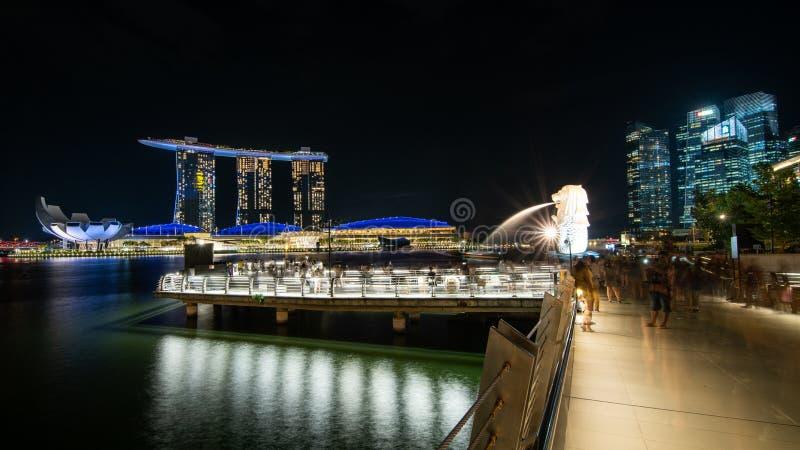 Merlion park and marina bay sand illuminated,landmark architecture at night in Singapore. royalty free stock image