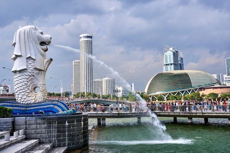 Merlion of Singapore spewing a stream of water into the river. The merlion of Singapore spewing a stream of water into the river royalty free stock photography