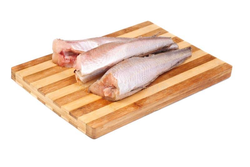 Merluches surgelées de poissons photographie stock