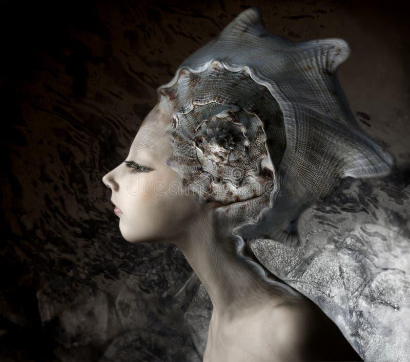Mermaid girl. In an unusual headgear, a hat
