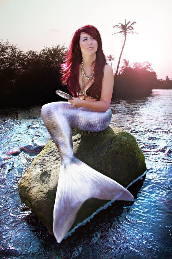 Mermaid On Paradise Island. Photo manipulation of a beautiful mermaid royalty free stock photography
