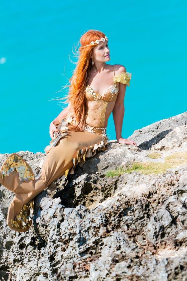 Mermaid on the rock royalty free stock photos