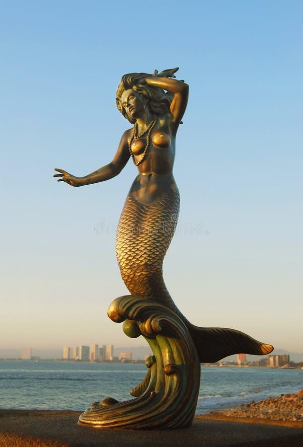 Mermaid sculpture. Beautiful mermaid bronze sculpture on the Port of Vallarta, Mexico stock photo
