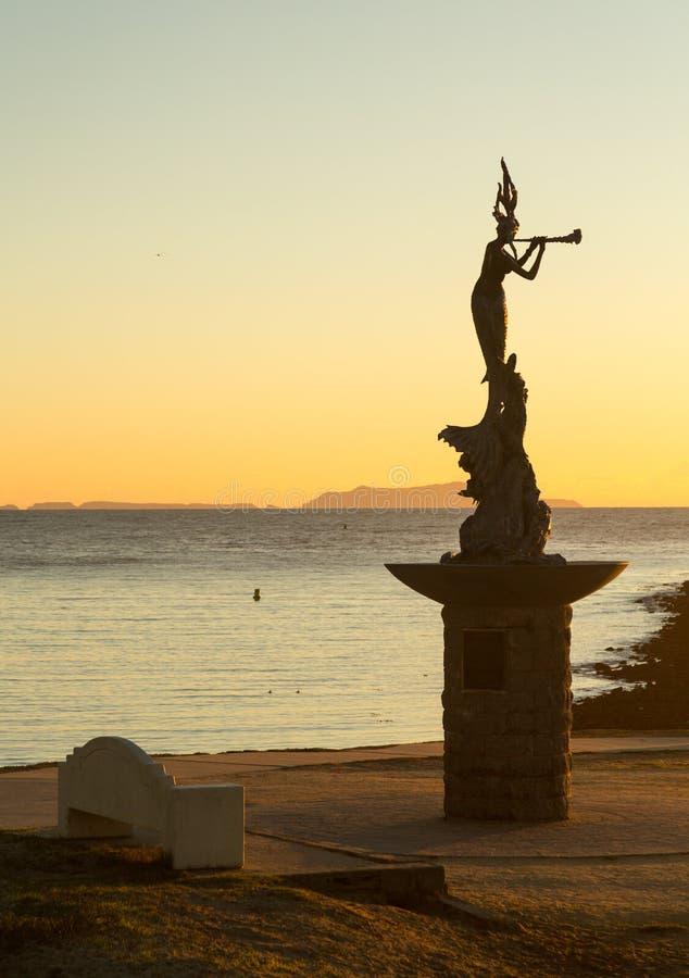 Mermaid statue entrance Ventura harbor royalty free stock image