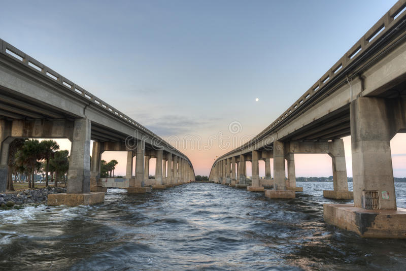 Merritt Island. With two causeways with sunrise and moon royalty free stock photography