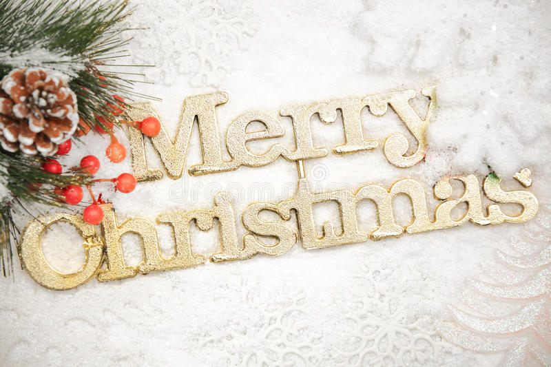 Merry Christmas. Ornament on snow stock image