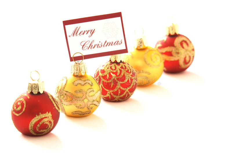 Merry Christmas. Christmas ornaments, one with message Merry Christmas, copyspace, shallow DOF royalty free stock photo