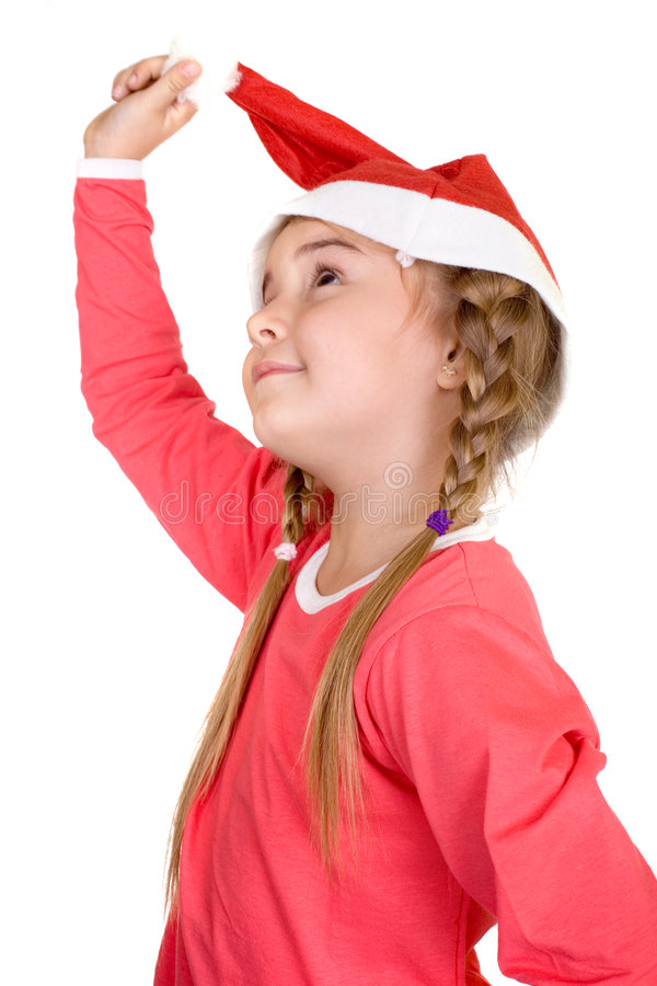 Merry Christmas. Cute little Santa girl, Christmas and New Year concept royalty free stock photography