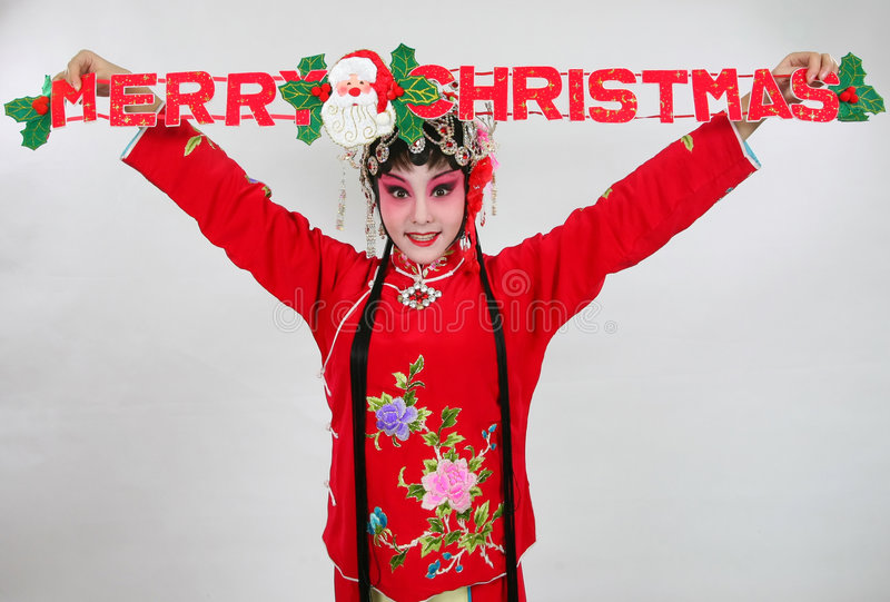 Merry christmas. Chinese drama actress hold merry christmas sign stock photo