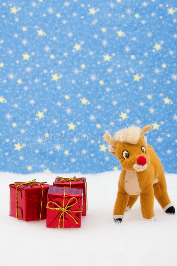 Merry Christmas. Reindeer in snow with presents on star background, merry Christmas royalty free stock images