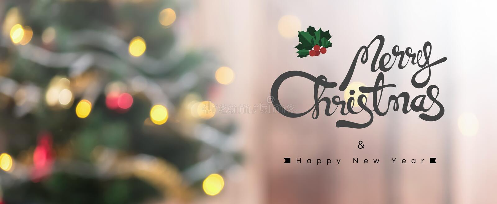 Merry Christmas ans Happy New Year text on colorful bokeh background. From decorated Christmas tree, panoramic banner stock photo