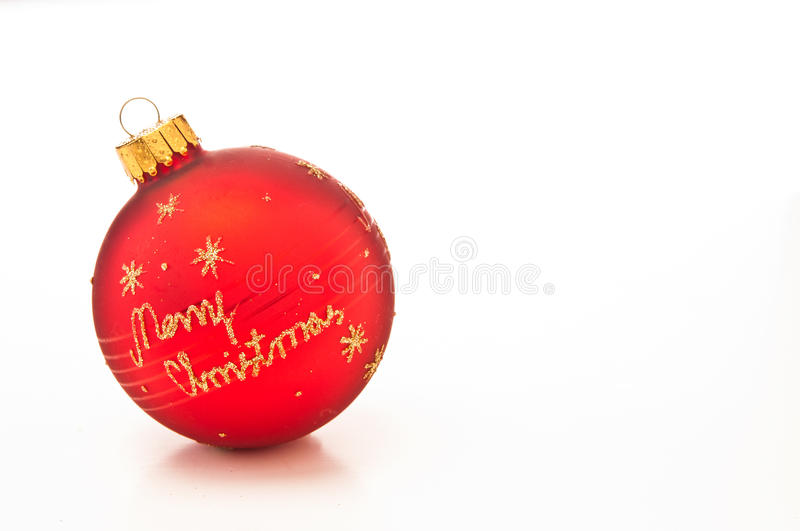 Merry Christmas bauble. 3d illustration of red bauble with words merry Christmas in gold letters, white background royalty free stock photography