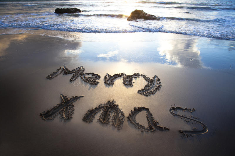 Download Merry Christmas On The Bech Stock Photo - Image of cloud, text: 16513924