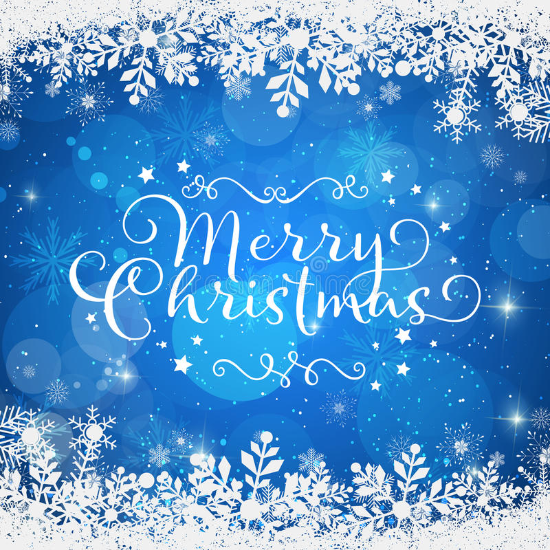 Merry christmas on a blue background in a snowy frame stock photos