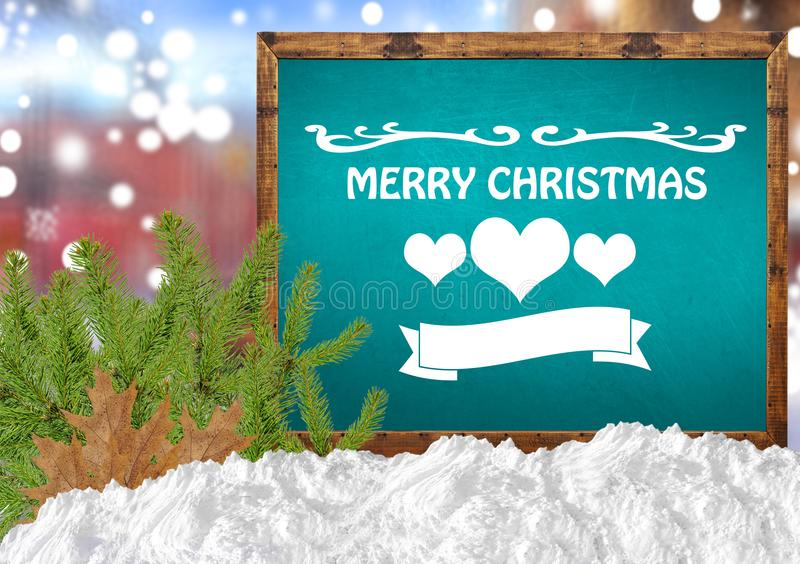 Merry Christmas on blue blackboard with blurr city pine and snow. Close stock photo