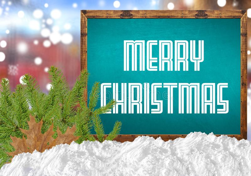 Merry Christmas on blue blackboard with blurr city pine and snow. Close royalty free stock photos
