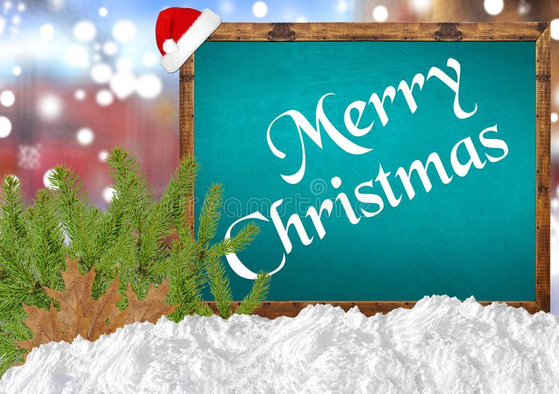 Merry Christmas on blue blackboard with blurr city pine and snow. Close stock photos