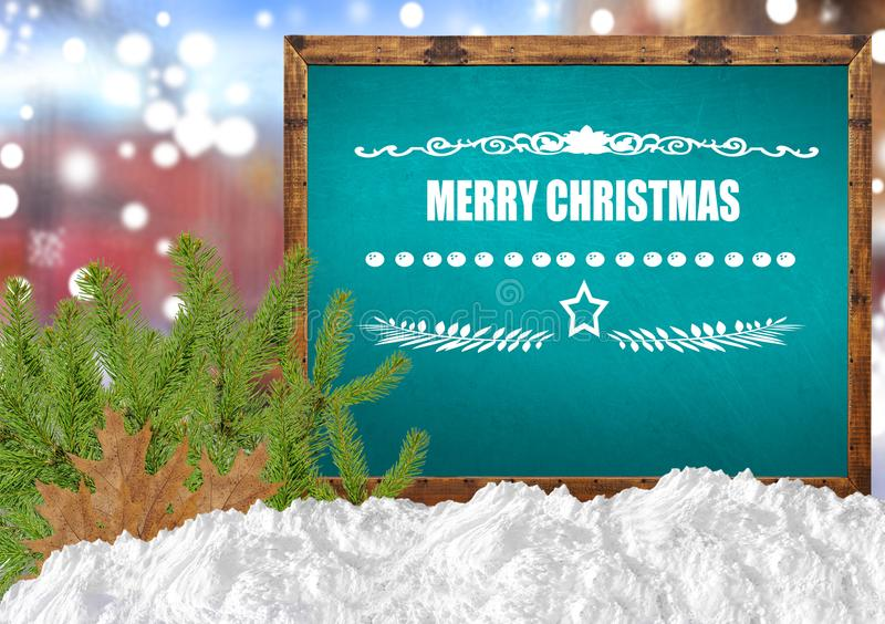 Merry Christmas on blue blackboard with blurr city pine and snow. Close stock photography