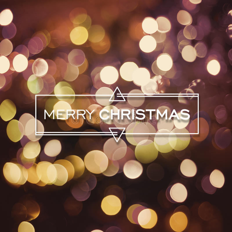Merry Christmas Card Text Label With Cute Geometry Elements On Gold Bokeh Light Background Ideal For Holiday Season Greetings Xmas Poster Or Web