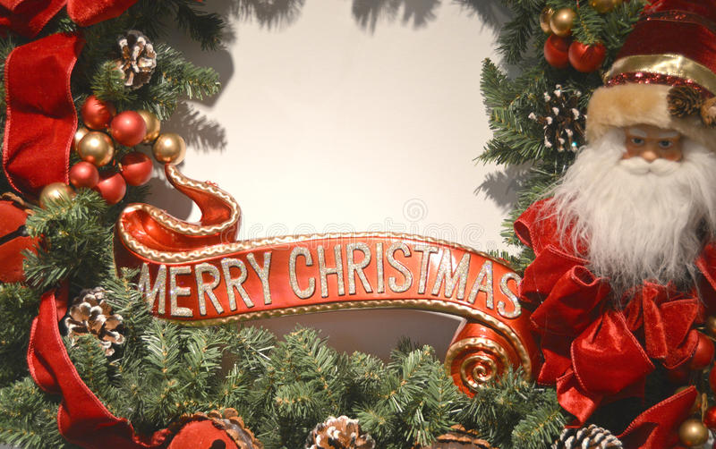 Merry Christmas Border. With Santa Claus, red and gold berries red ribbon and wording that says Merry Christmas on an evergreen wreath royalty free stock photos