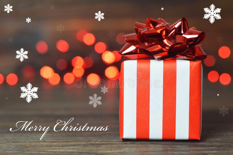 Merry Christmas card. Christmas gift with red bow stock photo