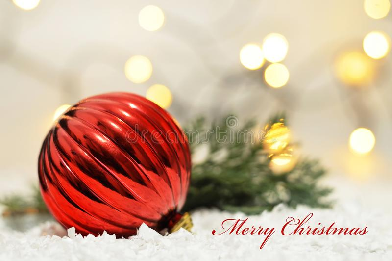 Merry Christmas card. Close up of red Christmas ball stock photography
