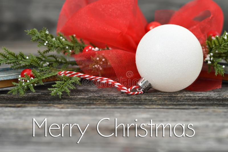 Merry Christmas card with Christmas decoration. On wooden background stock photo