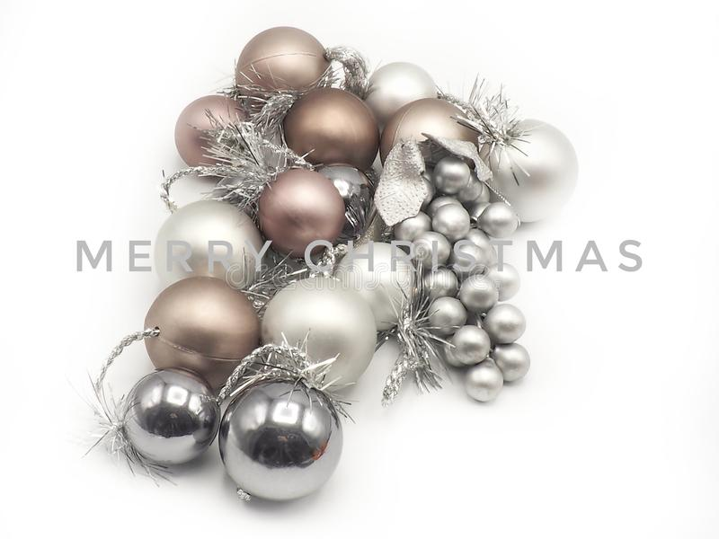 Merry Christmas card with silvered and golden balls in white background stock photos