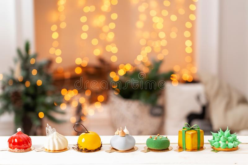 Merry Christmas card. Variety of sweet delicious cakes. Fir branches on a gray background. Merry Christmas card. New. Year mood royalty free stock images