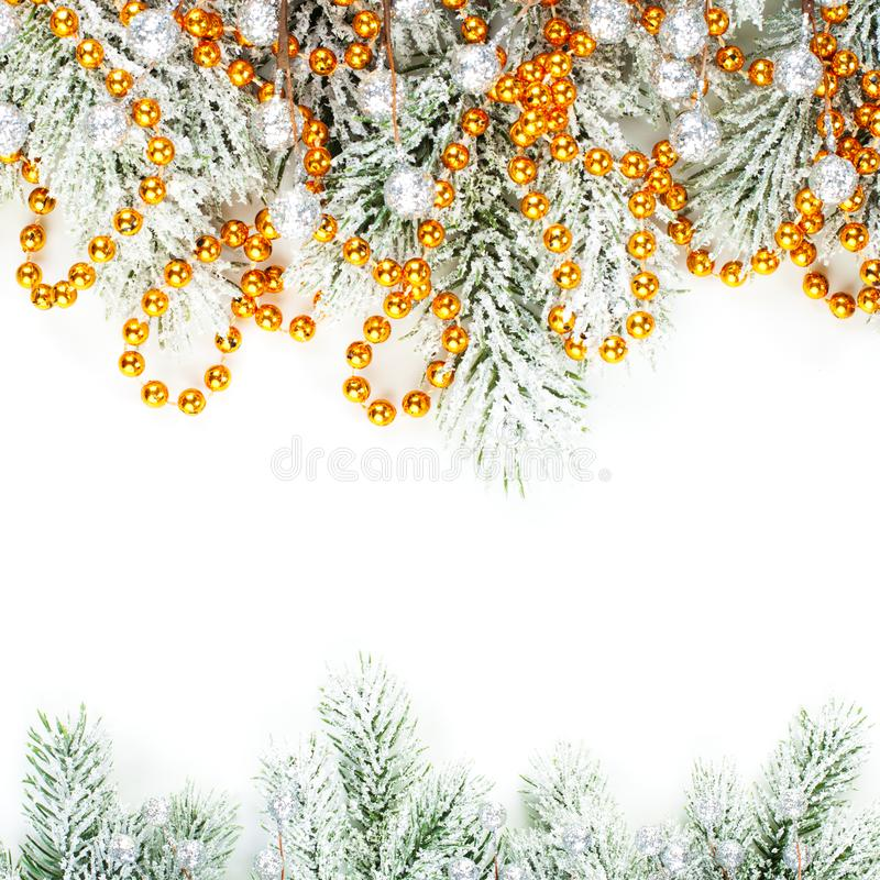 Merry Christmas card. Xmas composition border with winter fir branches, silver berries and gold garland isolated on white royalty free stock photo